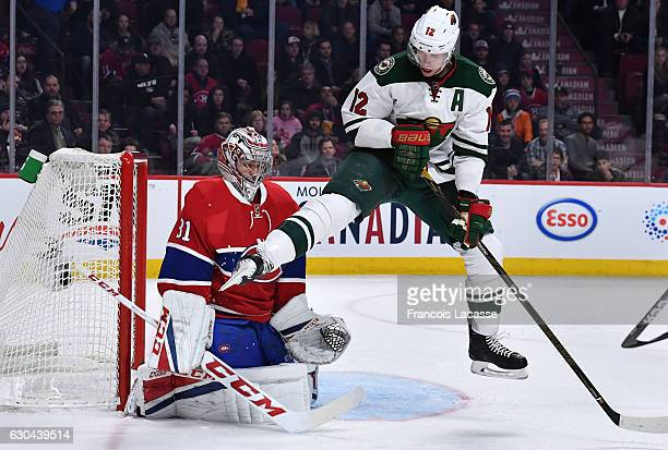 Eric Staal of the Minnesota Wild attempts to deflect the puck against Carey Price of the Montreal Canadiens in the NHL game at the Bell Centre on...