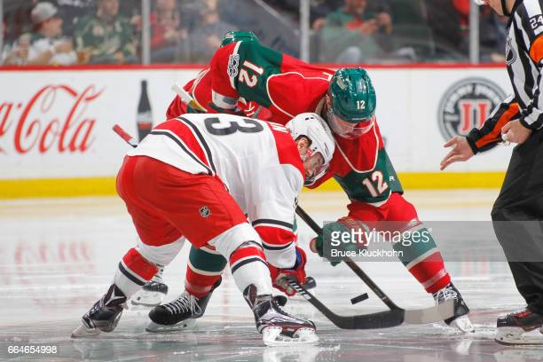 Eric Staal of the Minnesota Wild takes a faceoff against Derek Ryan of the Carolina Hurricanes during the game on April 4 2017 at the Xcel Energy...