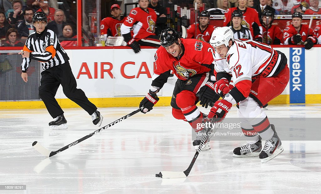 <a gi-track='captionPersonalityLinkClicked' href=/galleries/search?phrase=Eric+Staal&family=editorial&specificpeople=202199 ng-click='$event.stopPropagation()'>Eric Staal</a> #12 the Carolina Hurricanes skates with the puck against <a gi-track='captionPersonalityLinkClicked' href=/galleries/search?phrase=Marc+Methot&family=editorial&specificpeople=2216900 ng-click='$event.stopPropagation()'>Marc Methot</a> #3 of the Ottawa Senators, during an NHL game at Scotiabank Place on February 7, 2013 in Ottawa, Ontario, Canada.