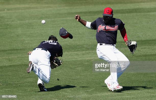 Eric Stamets of the Cleveland Indians and Abraham Almonte miscommunicate on a fly ball in the third inning against the Kansas City Royals during the...