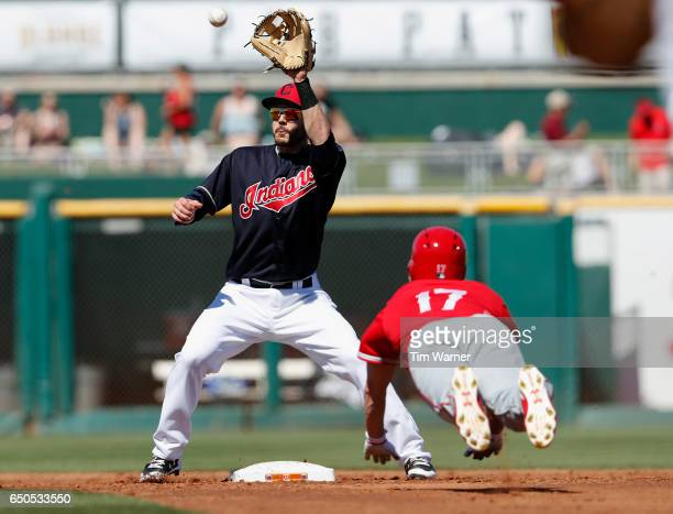 Eric Stamets of the Cleveland Indians fields a throw to second as Shane Robinson of the Los Angeles Angels of Anaheim attempts to steal in the third...