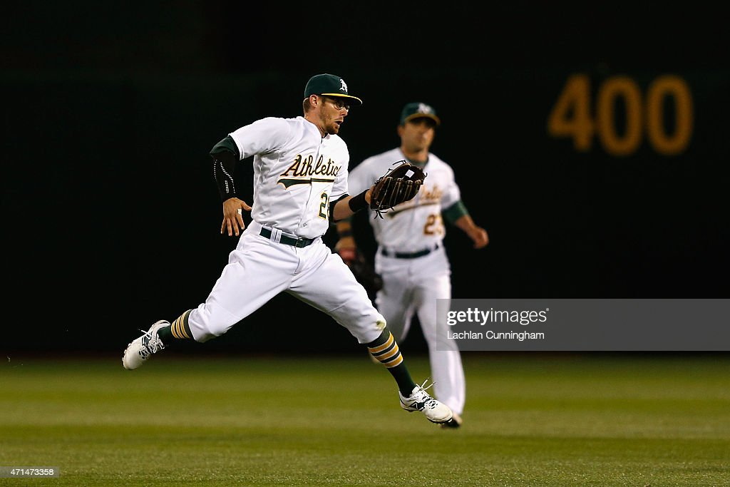 Eric Stogard #28 of the Oakland Athletics catches a fly ball hit by <a gi-track='captionPersonalityLinkClicked' href=/galleries/search?phrase=C.J.+Cron&family=editorial&specificpeople=7539229 ng-click='$event.stopPropagation()'>C.J. Cron</a> of the Los Angeles Angels of Anaheim in the seventh inning at O.co Coliseum on April 28, 2015 in Oakland, California.