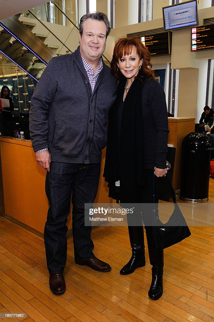 Eric Stonestreet (L) and Reba McEntire visit SiriusXM Studios on February 5, 2013 in New York City.
