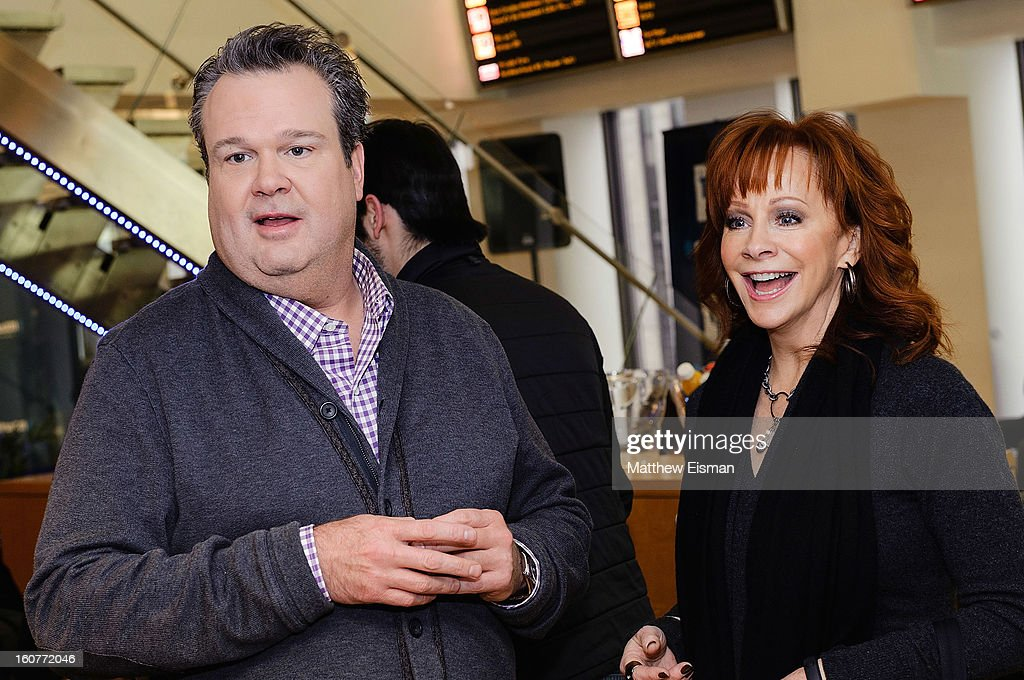 <a gi-track='captionPersonalityLinkClicked' href=/galleries/search?phrase=Eric+Stonestreet&family=editorial&specificpeople=6129010 ng-click='$event.stopPropagation()'>Eric Stonestreet</a> (L) and <a gi-track='captionPersonalityLinkClicked' href=/galleries/search?phrase=Reba+McEntire&family=editorial&specificpeople=202959 ng-click='$event.stopPropagation()'>Reba McEntire</a> visit SiriusXM Studios on February 5, 2013 in New York City.