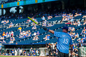 Eric Stonestreet points to the outfield before his atbat during the celebrity softball game for the Big Slick Celebrity Weekend benefiting Children's...