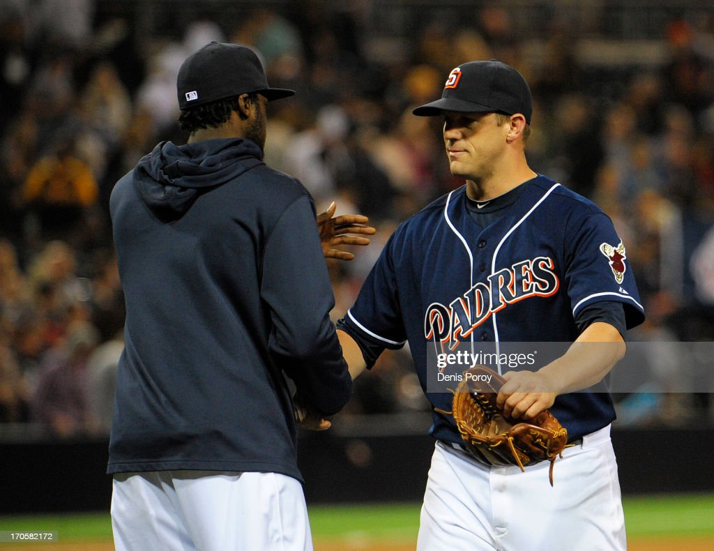 Eric Stults #53 (R) of the San Diego Padres is congraluted by <a gi-track='captionPersonalityLinkClicked' href=/galleries/search?phrase=Cameron+Maybin&family=editorial&specificpeople=2364846 ng-click='$event.stopPropagation()'>Cameron Maybin</a> #24 after the Padres beat the Arizona Diamondbacks 2-1 in a baseball game at Petco Park on June 14, 2013 in San Diego, California.