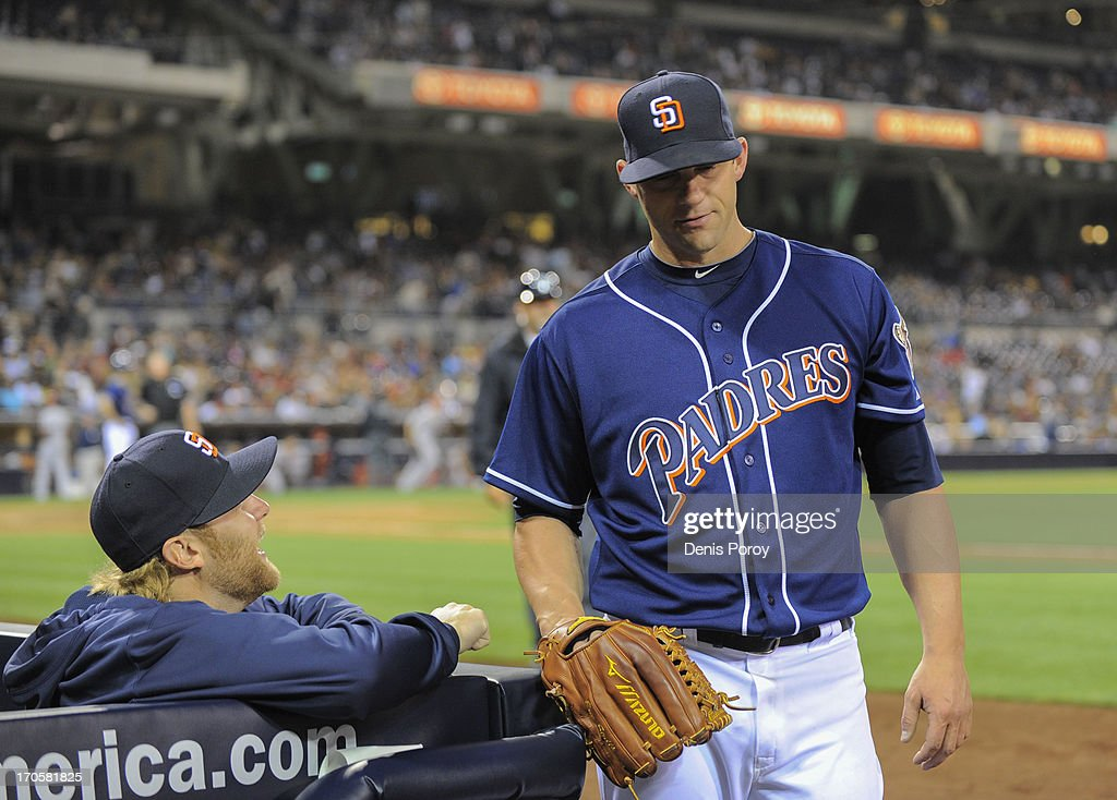 Eric Stults #53 (R) of the San Diego Padres talks with teammate <a gi-track='captionPersonalityLinkClicked' href=/galleries/search?phrase=Andrew+Cashner&family=editorial&specificpeople=5742254 ng-click='$event.stopPropagation()'>Andrew Cashner</a> #34 at the end of the seventh inning of a baseball game against the San Diego Padres at Petco Park on June 14, 2013 in San Diego, California.