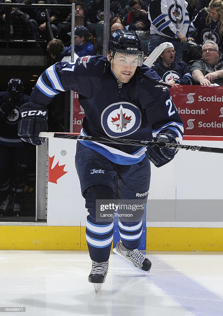 Eric Tangradi #27 of the Winnipeg Jets hits the ice prior to puck drop against the New York Rangers at the MTS Centre on March 14, 2013 in Winnipeg, Manitoba, Canada.