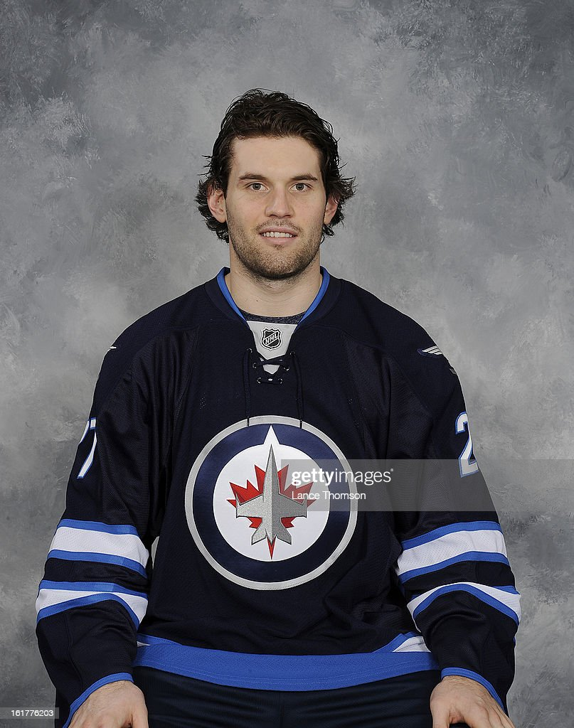 Eric Tangradi of the Winnipeg Jets poses for his official headshot for the 2012-2013 season on February 15, 2013 at the MTS Centre Winnipeg, Manitoba, Canada.