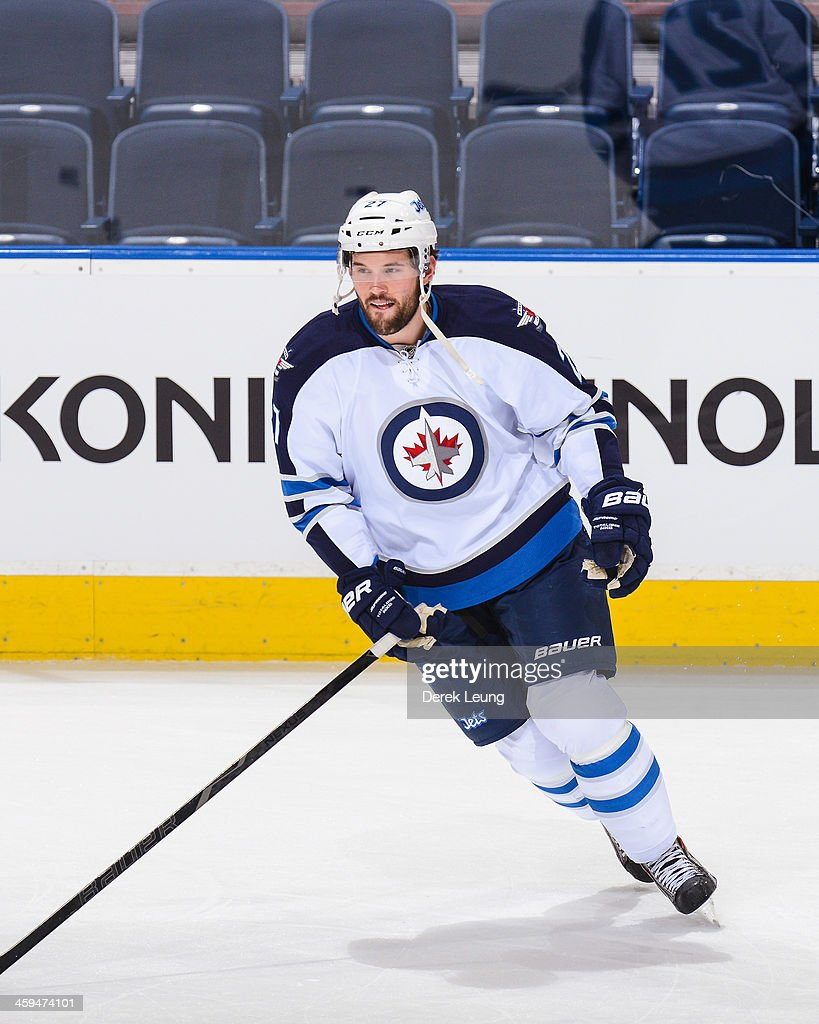 Eric Tangradi #27 of the Winnipeg Jets skates against the Edmonton Oilers during an NHL game at Rexall Place on December 23, 2013 in Edmonton, Alberta, Canada.