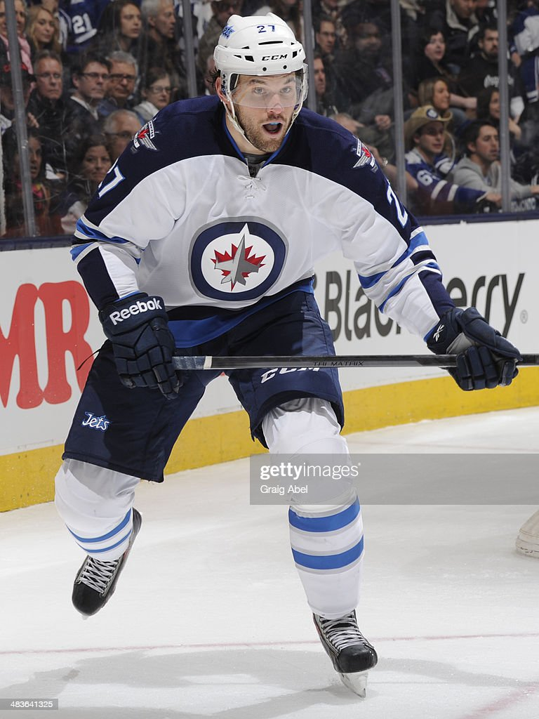 Eric Tangradi #27 of the Winnipeg Jets skates during NHL game action against the Toronto Maple Leafs April 5, 2014 at the Air Canada Centre in Toronto, Ontario, Canada.