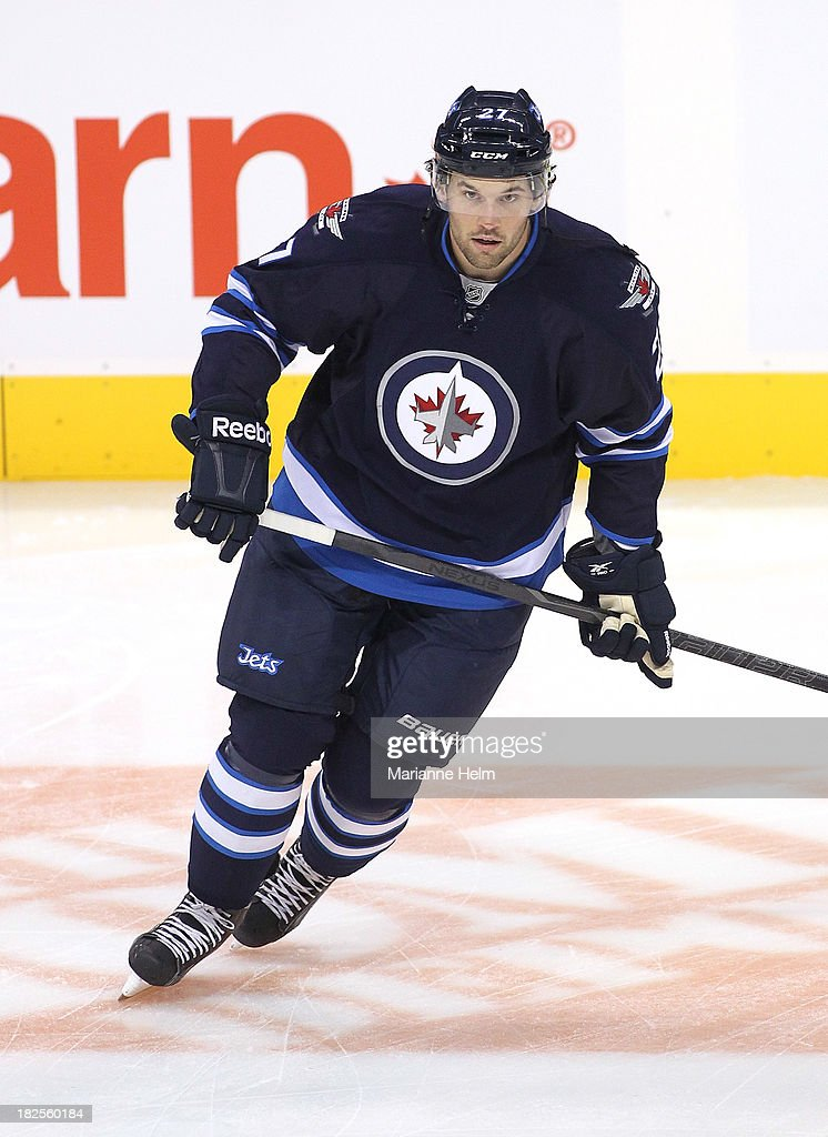Eric Tangradi #27 of the Winnipeg Jets skates during warmup before an NHL preseason game against the Boston Bruins at the MTS Centre on September 26, 2013 in Winnipeg, Manitoba, Canada.