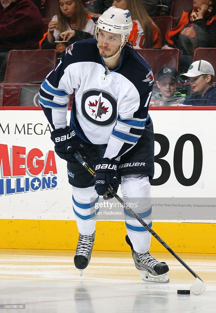 Eric Tangradi #27 of the Winnipeg Jets skates the puck against the Philadelphia Flyers on November 29, 2013 at the Wells Fargo Center in Philadelphia, Pennsylvania.