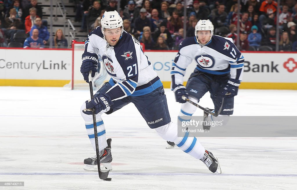 <a gi-track='captionPersonalityLinkClicked' href=/galleries/search?phrase=Eric+Tangradi&family=editorial&specificpeople=4361715 ng-click='$event.stopPropagation()'>Eric Tangradi</a> #27 of the Winnipeg Jets skates with the puck against the Colorado Avalanche at the Pepsi Center on December 29, 2013 in Denver, Colorado.Ê