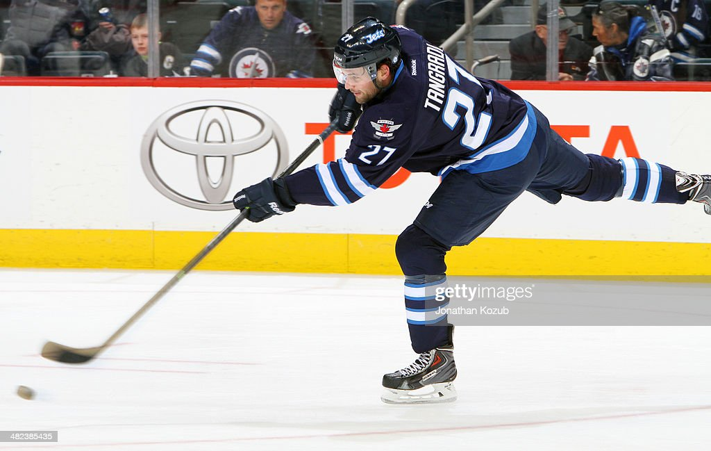 Eric Tangradi #27 of the Winnipeg Jets takes part in the pre-game warm up prior to NHL action against the Pittsburgh Penguins at the MTS Centre on April 3, 2014 in Winnipeg, Manitoba, Canada.