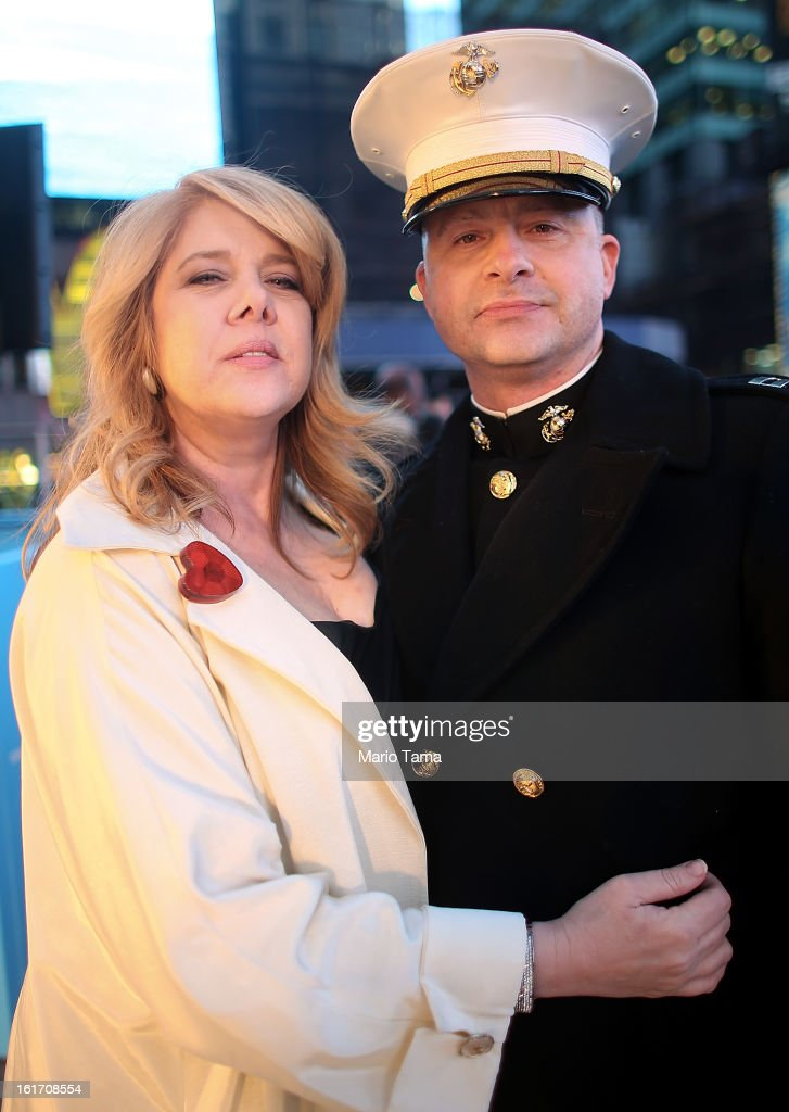 Eric Taush, with the United States Marine Corps, poses with wife Sue in Times Square on Valentine's Day on February 14, 2013 in New York City. The pair were planning to renew their vows during Valentine's Day celebrations in Times Square.
