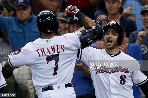 Eric Thames and Ryan Braunn of the Milwaukee Brewers celebrate after Thames hit a home run in the third inning against the Miami Marlins at Miller...