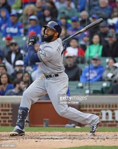 Eric Thames of the Milwaukee Brewers bats against the Chicago Cubs at Wrigley Field on April 19 2017 in Chicago Illinois The Cubs defeated the...