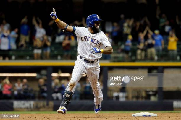 Eric Thames of the Milwaukee Brewers celebrates after hitting a walkoff home run against the San Diego Padres during the tenth inning at Miller Park...