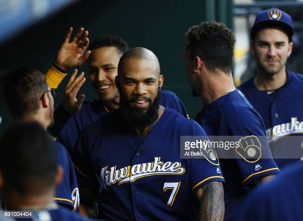 Eric Thames of the Milwaukee Brewers celebrates with teamates after hitting a two run home run against Jacob deGrom of the New York Mets in the first...