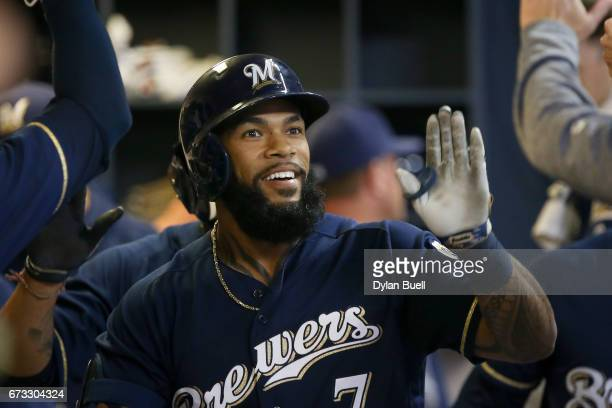 Eric Thames of the Milwaukee Brewers celebrates with teammates after hitting a home run in the sixth inning against the Cincinnati Reds at Miller...