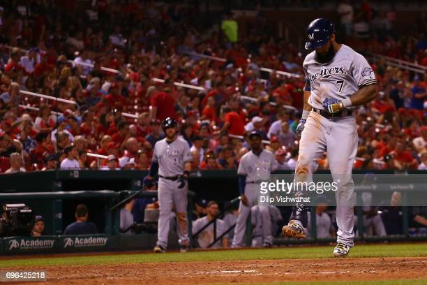 Eric Thames of the Milwaukee Brewers crosses home plate after hitting the gamewing tworun home run against the St Louis Cardinals in the ninth inning...