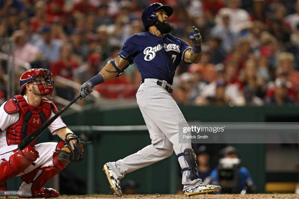 Eric Thames #7 of the Milwaukee Brewers follows through as he hits a home run against the Washington Nationals during the fifth inning at Nationals Park on July 25, 2017 in Washington, DC.