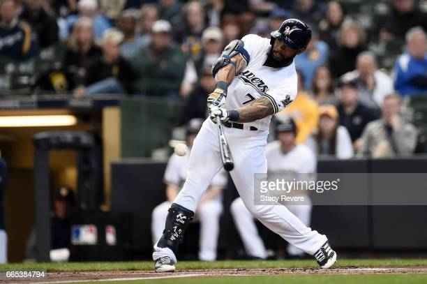 Eric Thames of the Milwaukee Brewers gets a base hit during the first inning of a game against the Colorado Rockies at Miller Park on April 6 2017 in...