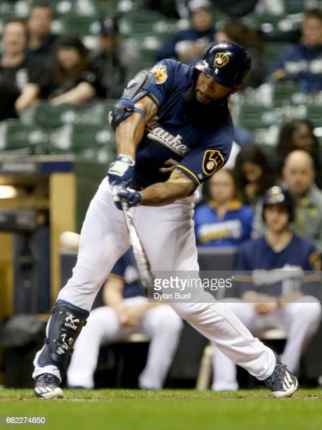 Eric Thames of the Milwaukee Brewers hits a double in the eighth inning against the Chicago White Sox during an exhibition game at Miller Park on...