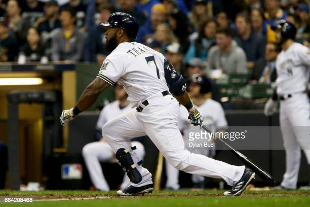 Eric Thames of the Milwaukee Brewers hits a double in the fifth inning against the Colorado Rockies of the MLB Opening Day game at Miller Park on...