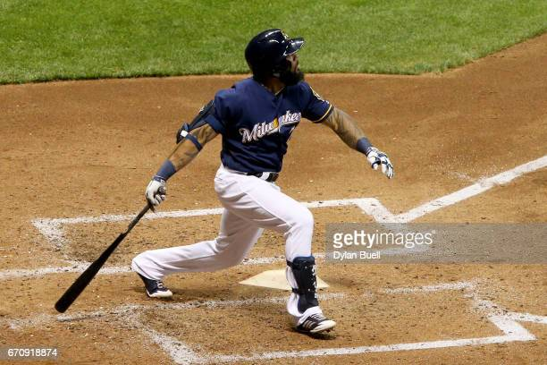 Eric Thames of the Milwaukee Brewers hits a home run in the fifth inning against the St Louis Cardinals at Miller Park on April 20 2017 in Milwaukee...