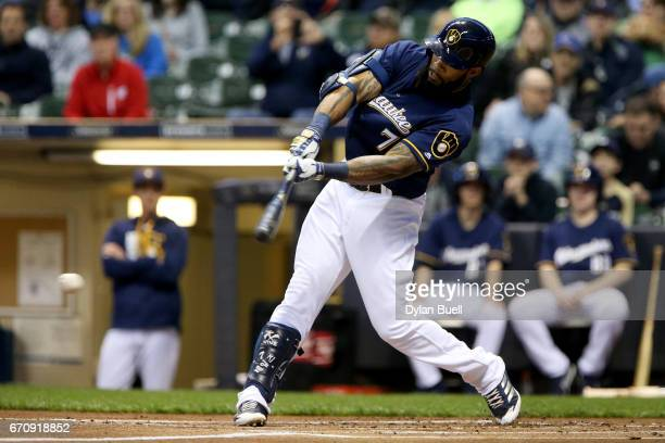 Eric Thames of the Milwaukee Brewers hits a single in the first inning against the St Louis Cardinals at Miller Park on April 20 2017 in Milwaukee...