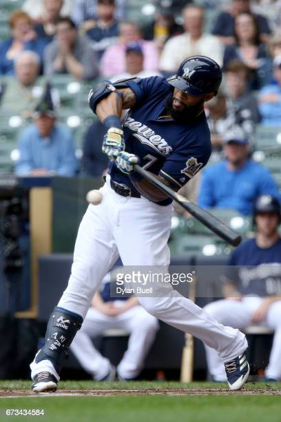 Eric Thames of the Milwaukee Brewers hits a single in the first inning against the Cincinnati Reds at Miller Park on April 26 2017 in Milwaukee...