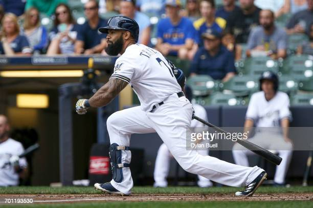 Eric Thames of the Milwaukee Brewers hits a single in the first inning against the Pittsburgh Pirates at Miller Park on June 22 2017 in Milwaukee...