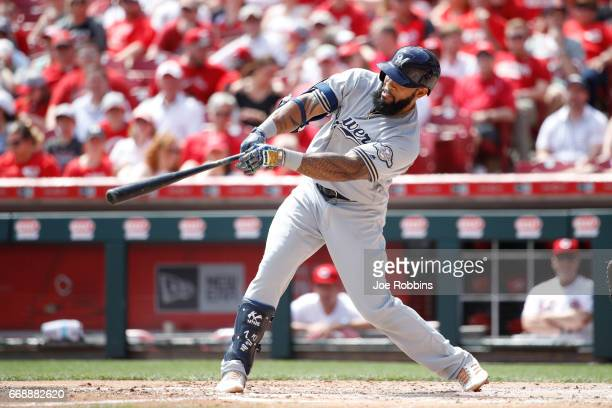 Eric Thames of the Milwaukee Brewers hits a solo home run to tie the game in the third inning against the Cincinnati Reds at Great American Ball Park...