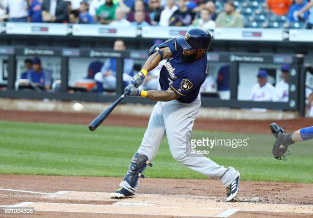 Eric Thames of the Milwaukee Brewers hits a two run home run against Jacob deGrom of the New York Mets in the first inning during their game at Citi...