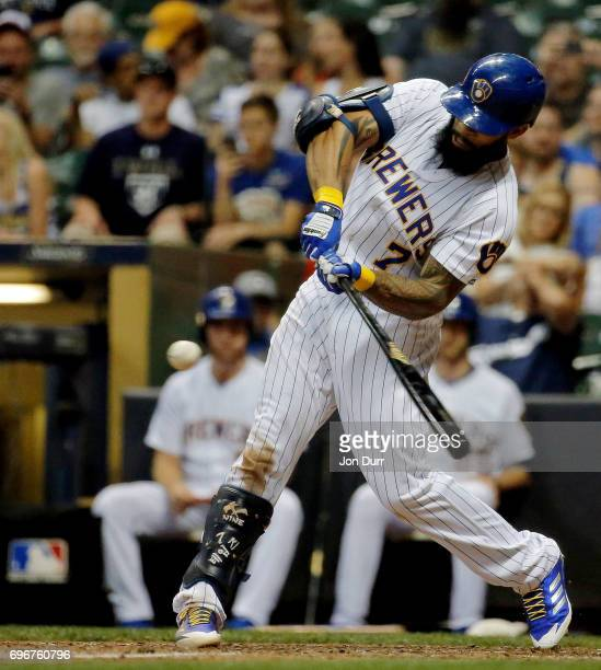 Eric Thames of the Milwaukee Brewers hits a walkoff home run against the San Diego Padres during the tenth inning at Miller Park on June 16 2017 in...