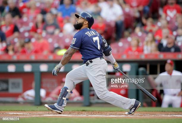 Eric Thames of the Milwaukee Brewers hits the ball in the first inning against the Cincinnati Reds at Great American Ball Park on April 13 2017 in...