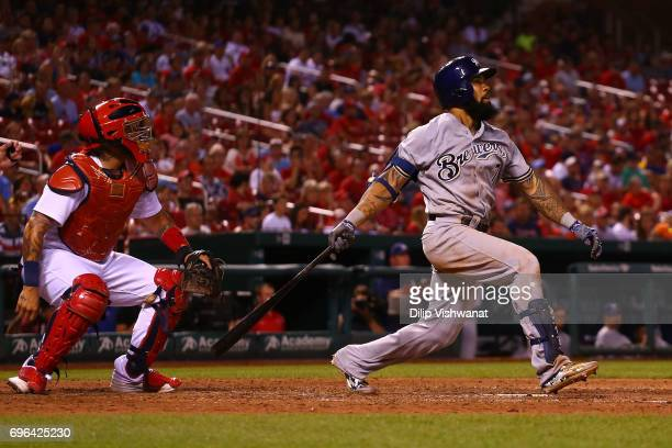 Eric Thames of the Milwaukee Brewers hits the gamewinning tworun home run as Yadier Molina of the St Louis Cardinals watches in the ninth inning at...