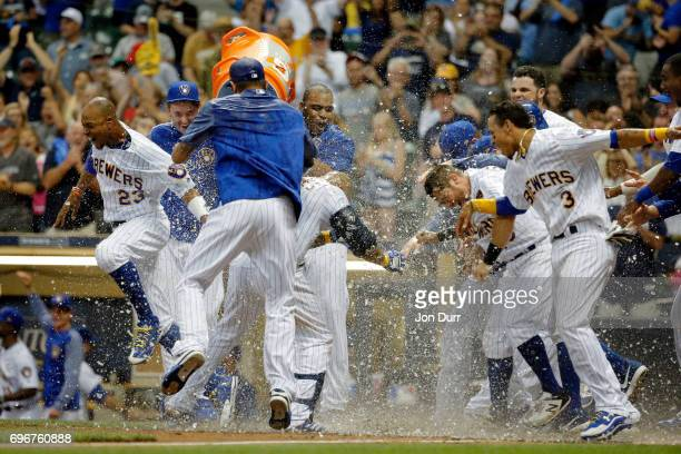 Eric Thames of the Milwaukee Brewers is dunked after hitting a walkoff home run against the San Diego Padres during the tenth inning at Miller Park...