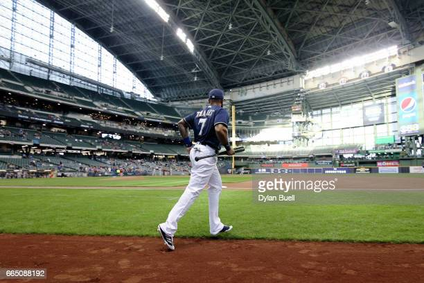 Eric Thames of the Milwaukee Brewers jogs onto the field before the game against the Colorado Rockies at Miller Park on April 4 2017 in Milwaukee...