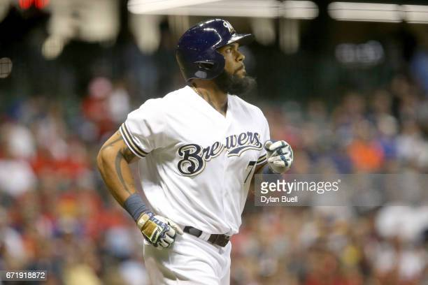 Eric Thames of the Milwaukee Brewers jogs to first base after walking in the sixth inning against the St Louis Cardinals at Miller Park on April 22...