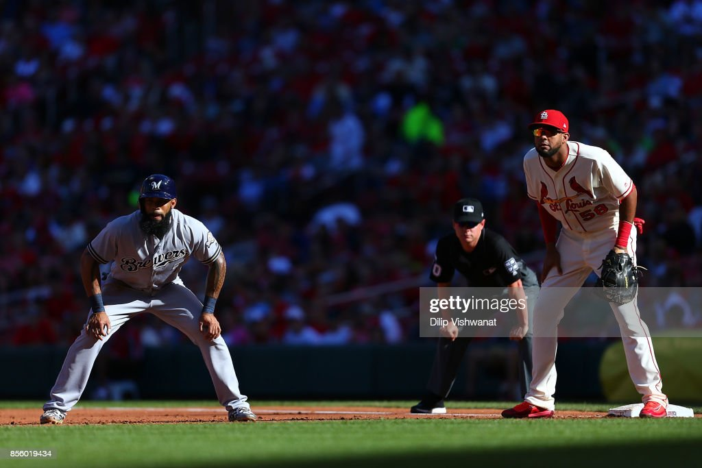Eric Thames #7 of the Milwaukee Brewers leads off first base against Jose Martinez #58 of the St. Louis Cardinals in the third inning at Busch Stadium on September 30, 2017 in St. Louis, Missouri.