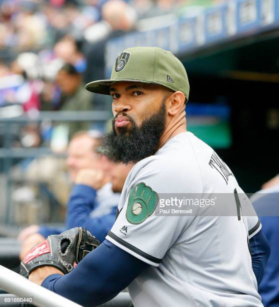 Eric Thames of the Milwaukee Brewers looks out to the field from the dugout in an MLB baseball game against the New York Mets on May 29 2017 at...