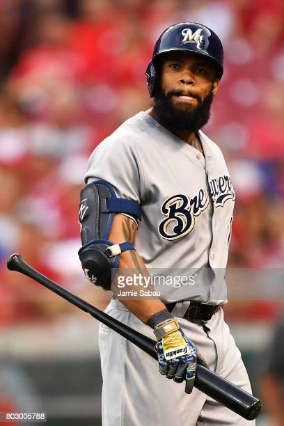 Eric Thames of the Milwaukee Brewers reacts after striking out in the fifth inning against the Cincinnati Reds at Great American Ball Park on June 28...
