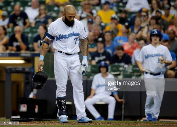 Eric Thames of the Milwaukee Brewers reacts after striking out against the San Diego Padres to end the eighth inning at Miller Park on June 17 2017...