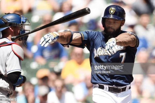 Eric Thames of the Milwaukee Brewers reacts to a strike out during the second inning of a game against the Los Angeles Dodgers at Miller Park on June...
