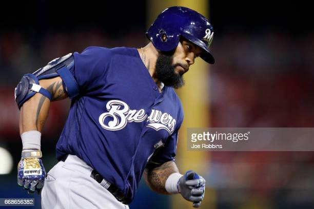 Eric Thames of the Milwaukee Brewers rounds the bases after hitting a tworun home run against the Cincinnati Reds in the sixth inning of a game at...