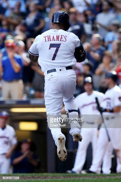 Eric Thames of the Milwaukee Brewers rounds the bases after hitting a home run in the fifth inning against the Baltimore Orioles at Miller Park on...