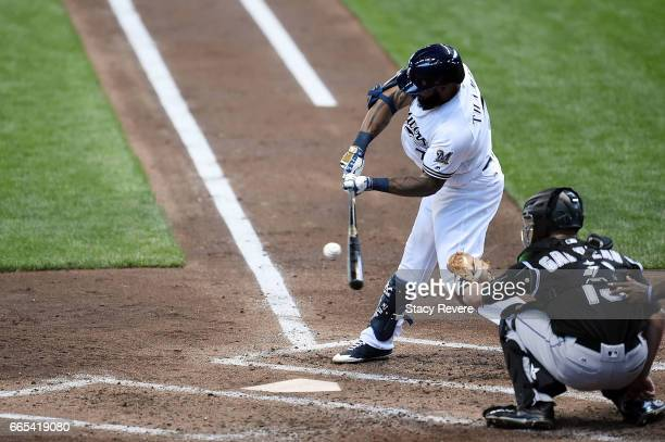 Eric Thames of the Milwaukee Brewers swings at a pitch during the third inning of a game against the Colorado Rockies at Miller Park on April 6 2017...
